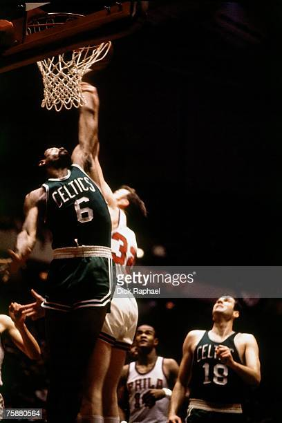 Bill Russell of the Boston Celtics attempts a dunk against the Philadelphia 76ers during an NBA game circa 19561969 at the Spectrum Arena in...