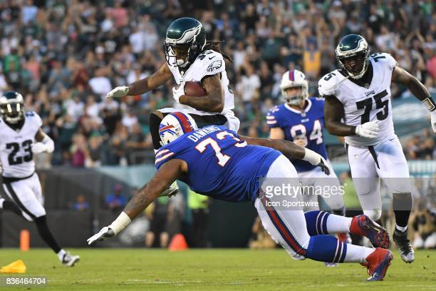Philadelphia Eagles corner back Ronald Darby Blount leaps over the tackle by Buffalo Bills offensive tackle Dion Dawkins during a NFL preseason game...