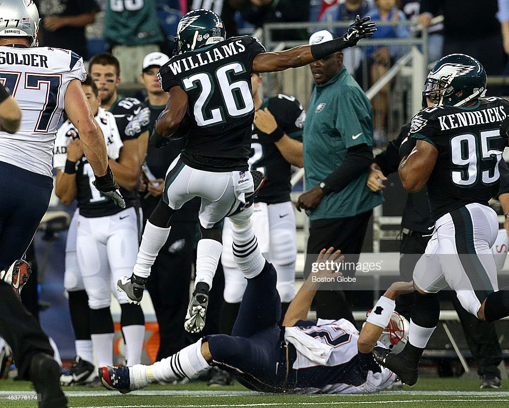 Philadelphia Eagles cornerback <a gi-track='captionPersonalityLinkClicked' href=/galleries/search?phrase=Cary+Williams+-+American+Football+Player&family=editorial&specificpeople=10178470 ng-click='$event.stopPropagation()'>Cary Williams</a> (#26) hurdles a prone New England Patriots quarterback <a gi-track='captionPersonalityLinkClicked' href=/galleries/search?phrase=Tom+Brady+-+American+Football+Quarterback&family=editorial&specificpeople=201737 ng-click='$event.stopPropagation()'>Tom Brady</a> (#12) who tried for an arm tackle on the Eagle cornerback who picked off a Brady pass and returned it for a Philadelphia TD in the first quarter. The New England Patriots take on the Philadelphia Eagles in a pre-season exhibition game at Gillette Stadium.