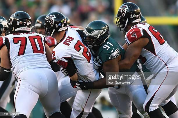 Philadelphia Eagles Defensive Tackle Fletcher Cox tackles Atlanta Falcons Quarterback Matt Ryan during a National Football League game between the...
