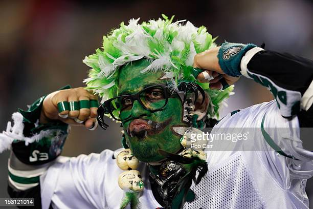 Philadelphia Eagles fans poses for photos before the start of the Eagles and New York Giants game at Lincoln Financial Field on September 30 2012 in...