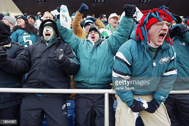 Philadelphia Eagles fans react after the Eagles score the game's first touchdown against the Tampa Bay Buccanneers during the NFC Championship game...