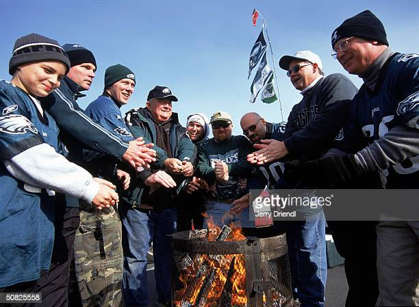 Philadelphia Eagles fans warm their hands over a grill before the game against the San Francisco 49ers at Lincoln Financial Field on December 21 2003...
