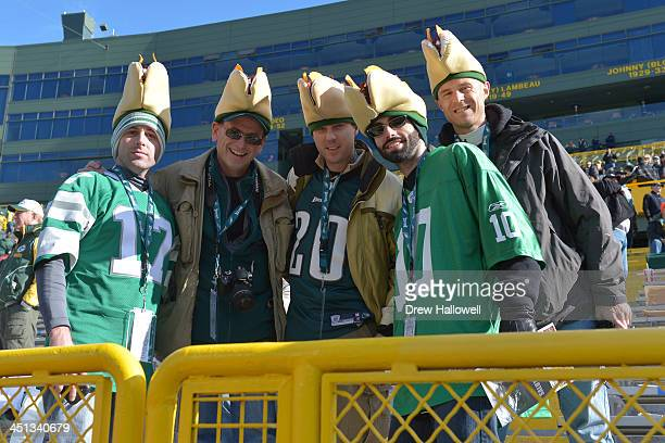 Philadelphia Eagles fans wearing cheesesteak hats pose for a photo before the game against the Green Bay Packers at Lambeau Field on November 10 2013...