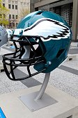Philadelphia Eagles NFL football helmet is on display in Pioneer Court to commemorate the NFL Draft 2015 in Chicago on April 30 2015 in Chicago...