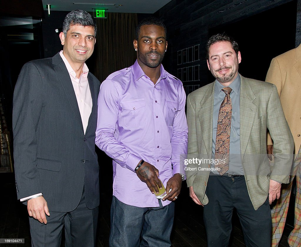 Philadelphia Eagles QB Michael Vick (center) and Tashan Restaurant & Lounge President and CEO Munish Narula (L) attend An Evening With 7, at 7, On the 7th at on January 7, 2013 in Philadelphia City.