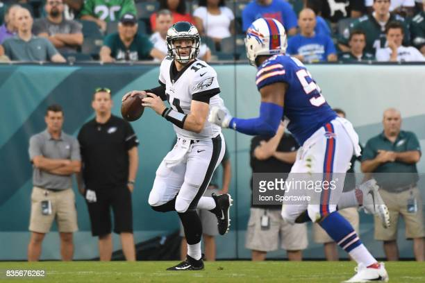 Philadelphia Eagles quarterback Carson Wentz is chased from the pocket by Buffalo Bills outside linebacker Lorenzo Alexander during a Preseason...