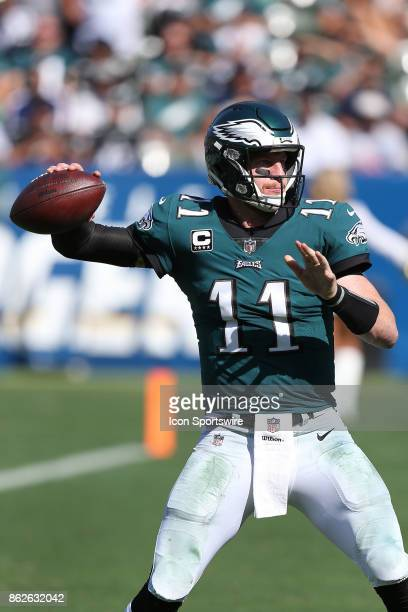 Philadelphia Eagles quarterback Carson Wentz looks to pass during the Philadelphia Eagles game versus the Los Angeles Chargers on October 1 at...