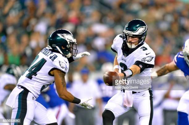 Philadelphia Eagles quarterback Matt McGloin hands off to Philadelphia Eagles running back DJ Pumphrey during the NFL preseason game between the...