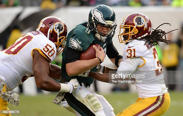 Philadelphia Eagles quarterback Nick Foles is caught by Washington Redskins outside linebacker Rob Jackson and safety Brandon Meriweather on November...