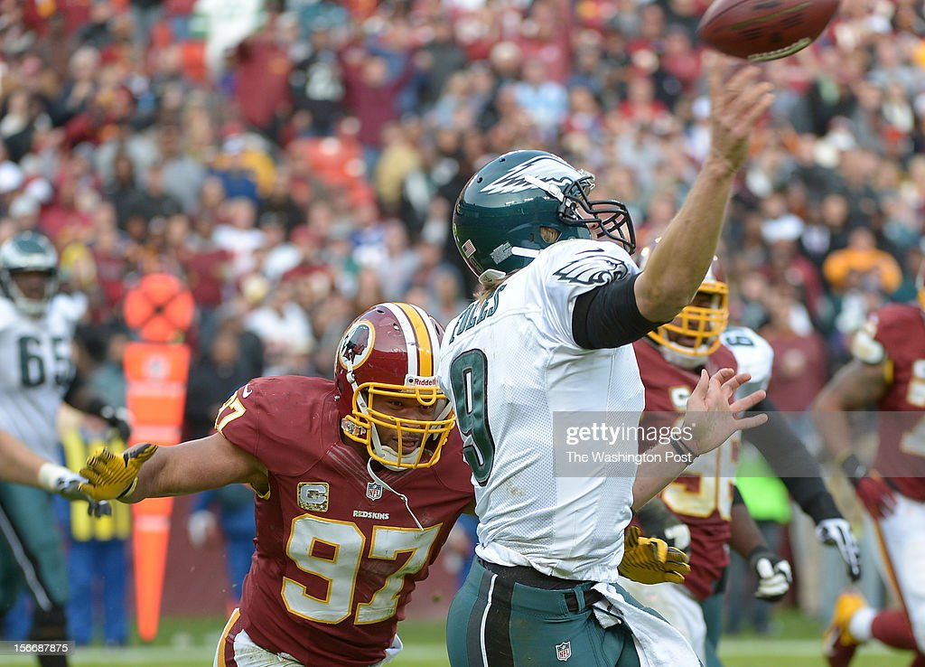 Philadelphia Eagles quarterback Nick Foles (9) releases a pass as Washington Redskins linebacker Lorenzo Alexander (97) applies pressure during 4th quarter action at FedEx field on November. 18, 2012 in Landover, MD