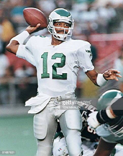 Philadelphia Eagles qurterback Randall Cunningham looks to pass in the first half against the Atlanta Falcons during preseason action in Philadelphia...