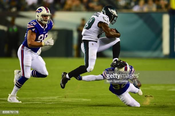Philadelphia Eagles running back Byron Marshall leaps over Buffalo Bills corner back Jumal Rolle during a Preseason National Football game between...