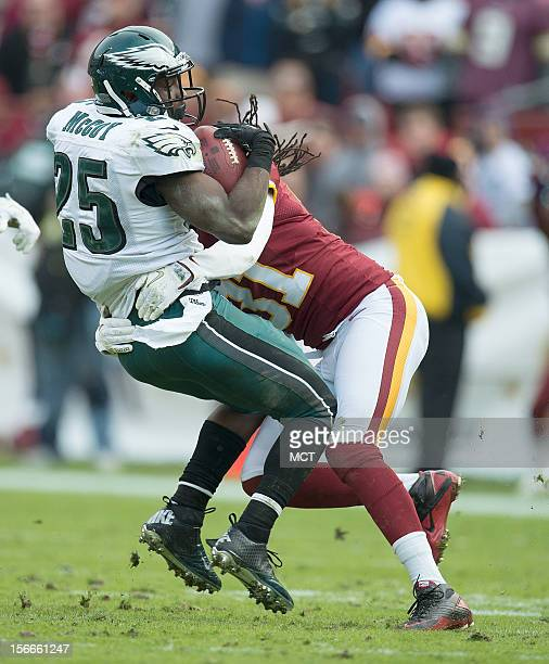 Philadelphia Eagles running back LeSean McCoy is hit hard by Washington Redskins defensive back Brandon Meriweather during the first half at FedEx...
