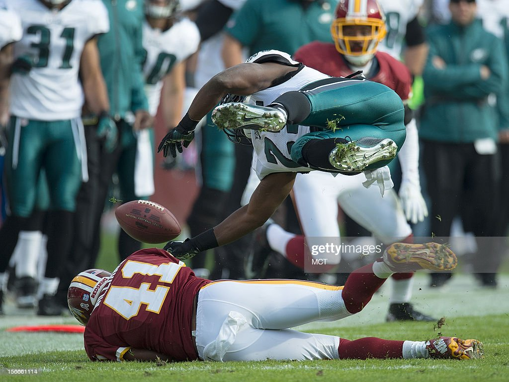 Philadelphia Eagles running back LeSean McCoy (25) is up-ended by Washington Redskins free safety Madieu Williams (41) during the first half at FedEx Field in Landover, MD, Sunday, November 18, 2012.