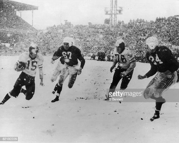 Philadelphia Eagles' Steve Van Buren runs the ball down the field during a playoff game Philadelphia Pennsylvania December 19 1948 Moving in on him...