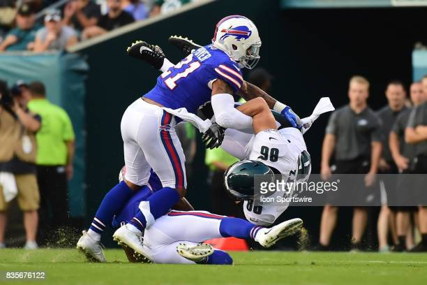 Philadelphia Eagles tight end Zach Ertz is upended by Buffalo Bills free safety Jordan Poyer during a Preseason National Football game between the...