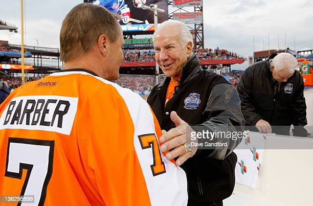 Philadelphia Flyers alumni Bill Barber shakes hands with Flyers owner Ed Snider before the start of the Alumni game prior to the 2012 Bridgestone NHL...