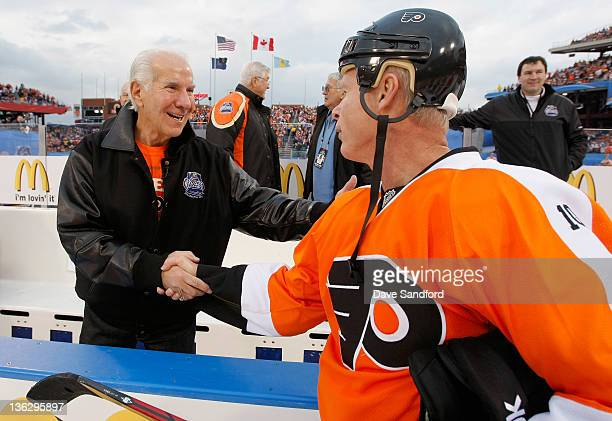 Philadelphia Flyers alumni Mark Howe shakes hands with Flyers owner Ed Snider before the start of the Alumni game prior to the 2012 Bridgestone NHL...