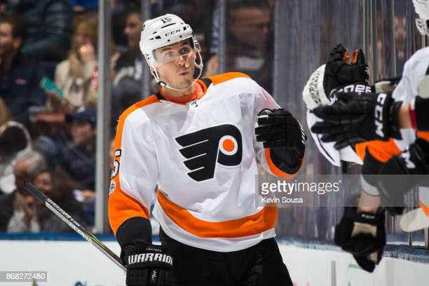 Philadelphia Flyers center Jori Lehtera is congratulated by teammates after scoring against the Toronto Maple Leafs during the second period at the...