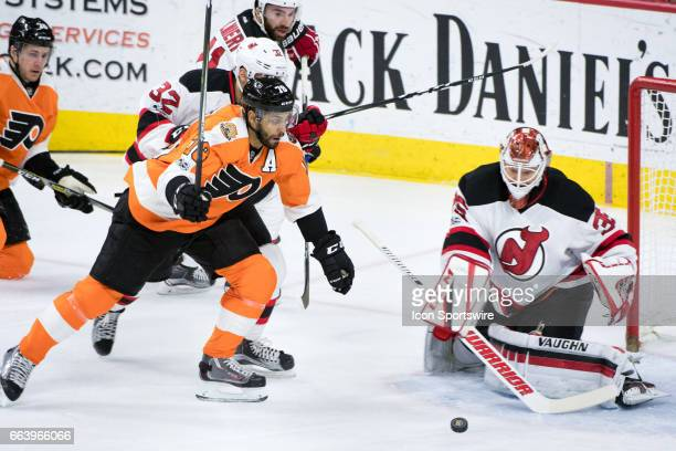 Philadelphia Flyers Center PierreEdouard Bellemare chases down the puck in front of the net in the first period during the game between the New...