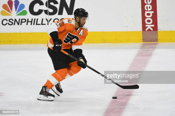 Philadelphia Flyers Center PierreEdouard Bellemare skates with the puck during a National Hockey League game between the Carolina Hurricanes and the...