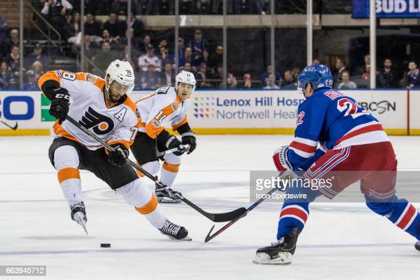 Philadelphia Flyers Center PierreEdouard Bellemare takes the puck into the Rangers zone during the third period of a Metropolitan Divisional matchup...
