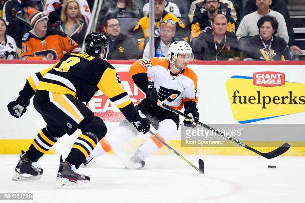 Philadelphia Flyers Center Scott Laughton handles the puck in front of Pittsburgh Penguins Defenseman Brian Dumoulin during the third period in the...