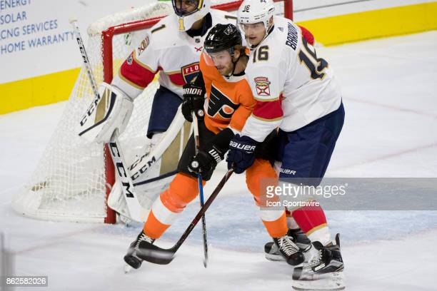 Philadelphia Flyers Center Sean Couturier and Florida Panthers Center Aleksander Barkov battle in front of the net in the first period during the...
