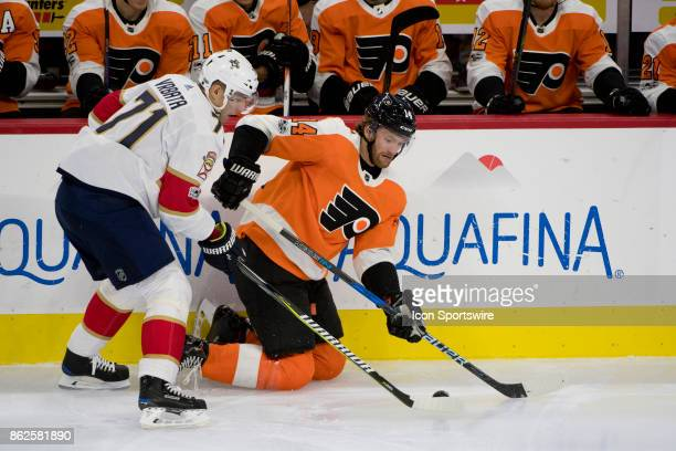 Philadelphia Flyers Center Sean Couturier and Florida Panthers Right Wing Radim Vrbata fight for the puck in the first period during the game between...