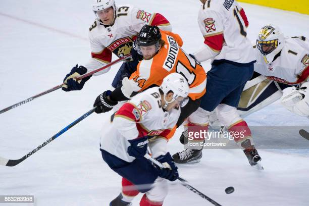 Philadelphia Flyers Center Sean Couturier watches the puck collected by Florida Panthers Right Wing Evgeny Dadonov in the second period during the...