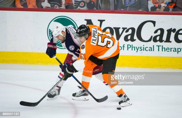 Philadelphia Flyers Center Valtteri Filppula and Columbus Blue Jackets Center Brandon Dubinsky fight for the puck in the third period during the game...