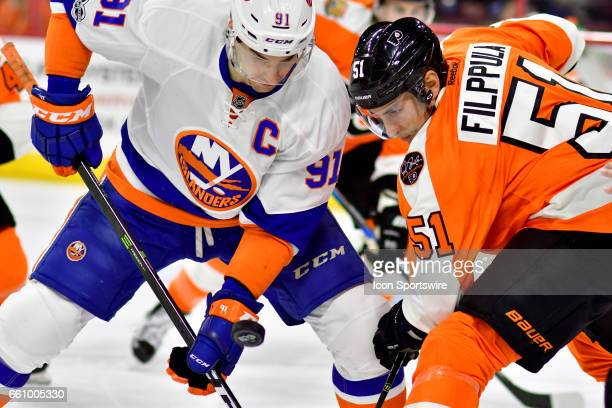 Philadelphia Flyers center Valtteri Filppula and New York Islanders center John Tavares face off during the hockey game between the New York...