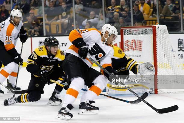Philadelphia Flyers center Valtteri Filppula looks for the back hand defended by Boston Bruins left defenseman Jeremy Lauzon during a preseason game...