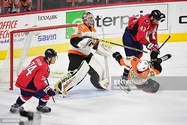 Philadelphia Flyers Defenceman Brandon Manning is upended by Washington Capitals Right Wing Tom Wilson during a National Hockey League game between...