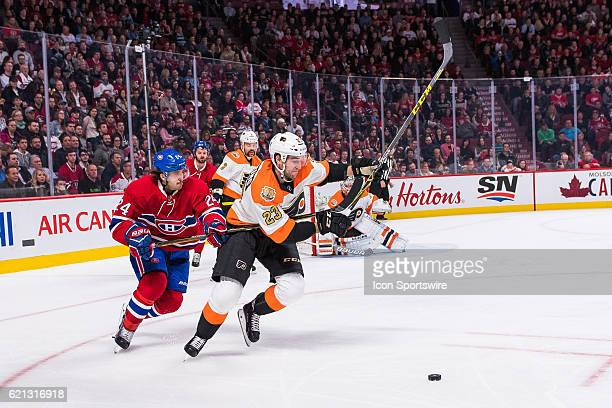 Philadelphia Flyers Defenceman Brandon Manning trying to get away with the puck but being chased by Montreal Canadiens Left Wing Phillip Danault...