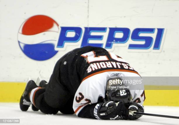 Philadelphia Flyers Eric Desjardins goes down with a concussion on Thursday November 3 2005 in Philadelphia PA The Philadelphia Flyers defeated the...
