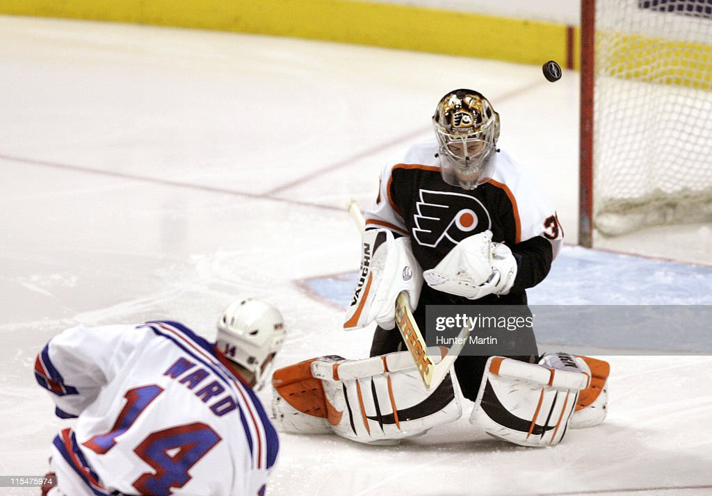 Philadelphia Flyers goalie Antero Niittymaki (30) makes a third period save against New York Rangers right winger Jason Ward (14) at the Wachovia Center in Philadelphia, Pennsylvania on March 2, 2006.