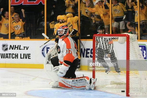 Philadelphia Flyers goalie Brian Elliott reacts as Nashville Predators right wing Pontus Aberg and Nashville Predators center Nick Bonino celebrate a...