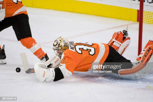 Philadelphia Flyers Goalie Michal Neuvirth dives to make a save in the first period during the game between the Florida Panthers and Philadelphia...