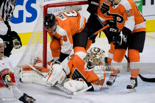 Philadelphia Flyers Goalie Michal Neuvirth looks up at Philadelphia Flyers Defenceman Robert Hagg after a save in the second period during the game...