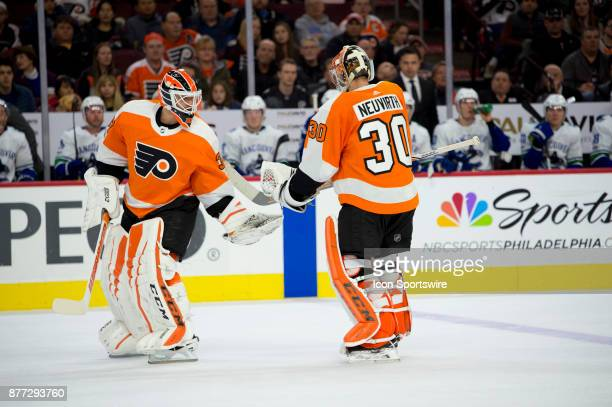 Philadelphia Flyers Goalie Michal Neuvirth passes Goalie Brian Elliott as Elliot is substituted in for Neuvirth in the second period during the game...
