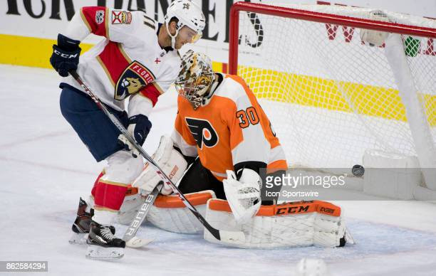 Philadelphia Flyers Goalie Michal Neuvirth saves a shot by Florida Panthers Left Wing Jonathan Huberdeau in the first period during the game between...