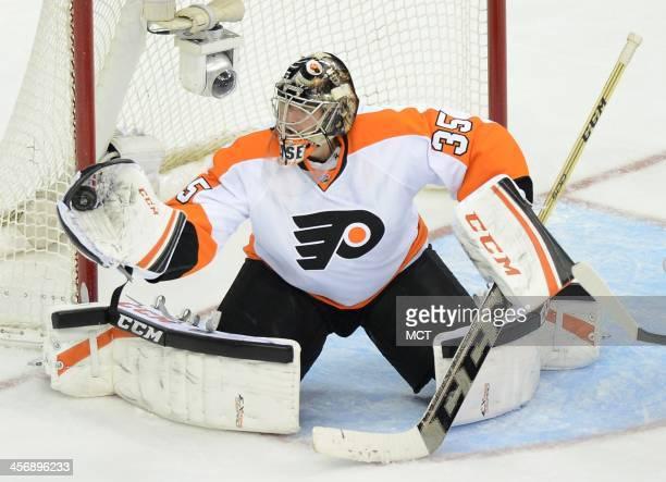 Philadelphia Flyers goalie Steve Mason makes a save against the Washington Capitals in the third period at the Verizon Center in Washington Sunday...