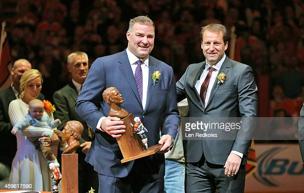 Philadelphia Flyers Hall of Fame inductee Eric Lindros displays his Hall of Fame bust during his Induction Ceremony with former teammate Mikael...