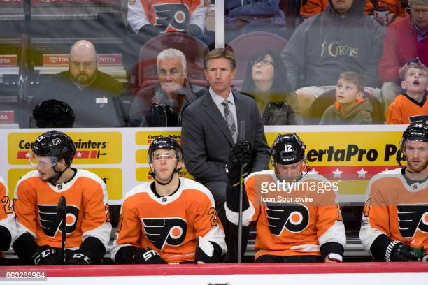 Philadelphia Flyers Head Coach Dave Hakstol looks on from the bench in the second period during the game between the Florida Panthers and...