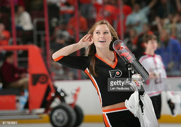 Philadelphia Flyers Ice Girl prepare to shoot TShirts into the crowd during the first period intermission against the Pittsburgh Penguins on October...