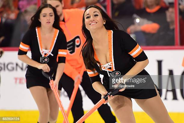 Philadelphia Flyers Ice Girls clean the ice during a NHL hockey game between the New Jersey Devils and the Philadelphia Flyers on January 21 at the...
