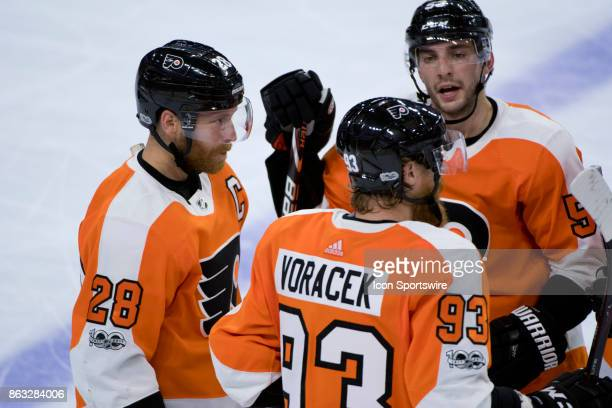 Philadelphia Flyers Left Wing Claude Giroux meets with Right Wing Jakub Voracek and Defenceman Shayne Gostisbehere in the third period during the...