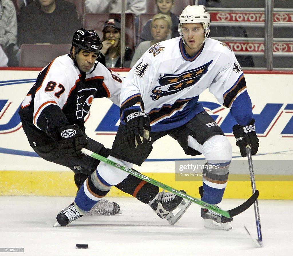 Philadelphia Flyers left wing Donald Brashear knocks the puck away from Washington Capitals defenseman Steve Eminger on Thursday November 3 2005 in...